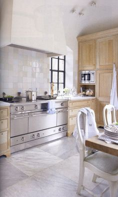 Add some stainless steel for a sleek look but keep it calm with wood elements. Kitchen Home Decor