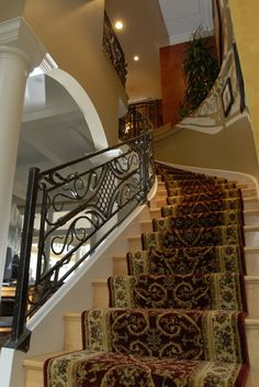 Custom Made Custom Hand Forged Curved Railing with Flower Detail by ARC IRON CREATIONS