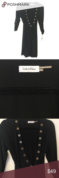REDUCEDNWT Calvin Klein black wrap dress New with tags black Calvin Klein wrap dress. Deep plunge neckline with gold grommets. Sleeves roll up and button. Condition: new! Measurements:  happily given upon request. Note: 20% discount when you bundle 2+ items in my closet! Calvin Klein Dresses Mini