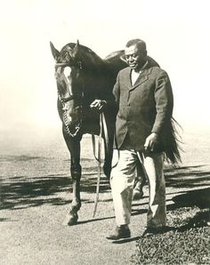 """Man o' War didn't need no excuses. He broke all the records and he broke down all the horses, so there wasn't nothing for him to do but retire. He's got everything a horse ought to have, and he's got it where a horse ought to have it. He's just de mostest hoss. Stand still, Red.""    Man O' War and Will Harbutt  Photograph: Weddle James Edwin"