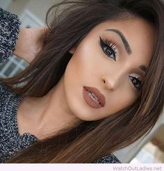 Awesome brown hair and make-up, love her golden detail