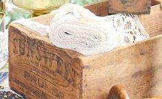 Storage via vintage wooden crate.