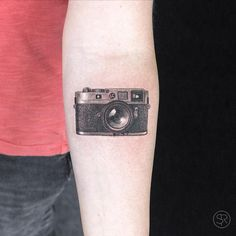 Leica camera tattoo by Sven Rayen