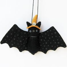 Halloween bats! needle felted bat ornament with orange witch hat  Fuzz bat knows…