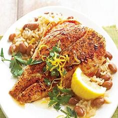 Cajun Snapper with Red Beans and Rice | Cajun seasoning, lemon peel, and fresh parsley spice up fresh snapper. Red beans and long-grain rice complete the dish.