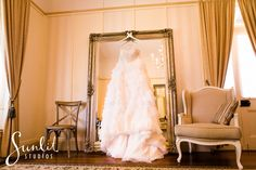 Perfect setting for a bride to get ready. Love hanging the beautiful dress on a mirror! Taken at Gabbinbar Homestead, Toowoomba by photographers Sunlit Studios
