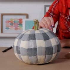 Add a touch of farmhouse style to your fall decor with a classic gingham print. These DIY buffalo check pumpkins are simple to make and will be a fabulous modern addition to your lineup of painted pumpkins. Buffalo Check, Buffalo Print, Diy Pumpkin, Fall Pumpkin Crafts, Pumpkin Ideas, Painted Pumpkins, Best Paint For Pumpkins, Painted Halloween Pumpkins, Bricolage Facile