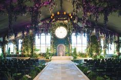 Transform an indoor space into a botanical garden with ivy-covered walls, flowers hanging from the ceiling, and potted plants lining the aisle.Related: 20 Eye-Catching Ideas for Your Ceremony Backdrop