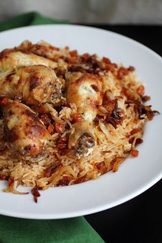 KABSA aka MACHBUS ~~~ a kabsa is a meat and rice dish generally made with black pepper, cloves, cardamom, saffron, cinnamon, black lime, bay leaves, nutmeg, and a type of meat (chicken, goat, lamb, camel, beef, fish, or shrimp). the spices, rice, and meat may be augmented with almonds, pine nuts, peanuts, onions and/or sultanas. [Saudi Arabia] [adventuressheart]