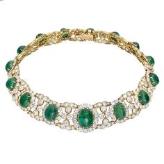 M.GERARD A Magnificent Cabochon Emerald and Diamond Necklace, France, 1978. photo by Betteridge Jewelers   A magnificent cabochon emerald and diamond collar necklace, designed as a series of fifteen oval cabochon emerald and circular-cut diamond clusters with diamonds scroll motif intersections, mounted in gold, circa 1978. Price $195,000   Monsieur Louis Gerard was formally an executive at Van Cleef & Arpels and founded his own company with the assistance of Comtesse de Ribes in 1968.