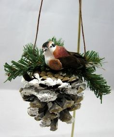 This pine cone perch for a brown bird is frosted with snow and topped with pine branches.This would be perfect for anyone looking for a nature themed tree. It also blends well with the rustic birdhouse ornaments that are available in this shop. We are happy to combine shipping for items