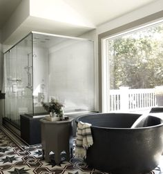I mean... The ultimate bathing luxury? A free-standing, round bathtub built for two. Here are 10 in serenely romantic settings from Remodelista