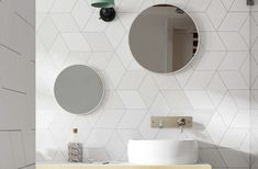 White bathroom with clean lines. Feature wall from Rhombus tile collection by Equipe Ceramicas.