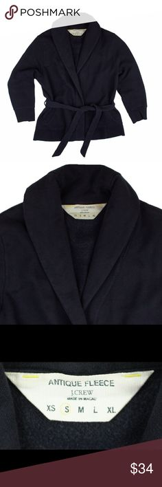 """JCREW Navy Antique fleece Cardigan Sweatshirt Top Great condition! This navy blue antique fleece sweat shirt from JCREW features a cardigan style and tie closure at waist. 3/4 length sleeves. Made of a cotton blend. Measures: bust: 37"""", total length: 22"""", sleeves: 18.5"""" J. Crew Tops Sweatshirts & Hoodies"""