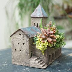 Little building planter, Clay or coated paperclay.