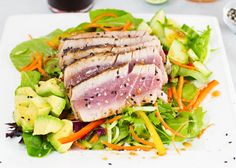 Seared Ahi Salad served with homemade Ginger Sesame Dressing over a bed of fresh greens. It's the perfect light and delicious meal!!
