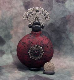 Wickedly wonderful Gothic magic potion / oil/ perfume bottle made from a christmas ornament , it is glass inside so it does need extra care!