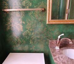 Our Antoinette Damask stencil shines in Antique Gold Stencil Creme over an emerald green glazed wall. | Artist: E. Lee Jahncke