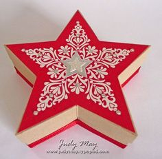 Star box with really good directions. http://judymay.typepad.com/just_judy_designs/2014/09/3d-star-boxes.html