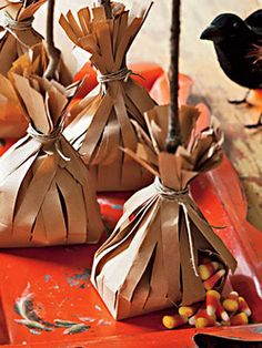 Recycled paper bags already have a distressed look which is perfect for mimicking the disheveled head of a witch's broom. Stuff them with candy for a sweet surprise! #Halloween
