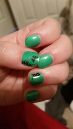 Green nails with butterfly and flower decals
