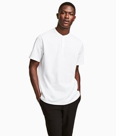 White. T-shirt in cotton piqué with a small stand-up collar and button placket.