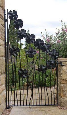 A beautiful wrought iron flower gate.