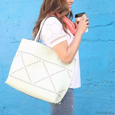 I have been seeing these laser cut tote bags everywhere! The perfect Spring accessory! #stitchfix