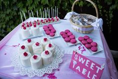 Deep pink #wedding #Candy #Bar with mini tarts, macarons, cake pops and personalised ginger breads. From our #real #summer #wedding in garden.