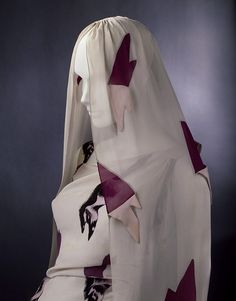 Evening ensemble (dress and veil) | The Tear Dress from The Circus Collection | Designed by Elsa Schaparelli (1890-1973) and Salvador Dalí (1904-1989) | Made in Paris, February 1938 | Materials: viscose-rayon and silk blend fabric printed with trompe l'oeil print | 'Tears' print was specially designed by Schiaparelli's friend, the artist Salvador Dali.| VA Museum, London