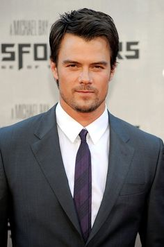 Pin for Later: 45 Really, Ridiculously Good-Looking Pictures of Josh Duhamel  Josh gave a sexy stare in June 2009 at the premiere of Transformers: Revenge of the Fallen in LA.