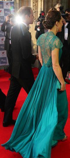 Flowing: The stunning Dress had pleated detail on the back and a small bow, with tiny buttons going up to the nape of the neck