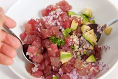 oil 1/4 cup fresh cilantro, rough chopped to taste Refrigerate the diced tuna until ready to use. Place the onion in a small bowl of cold w...