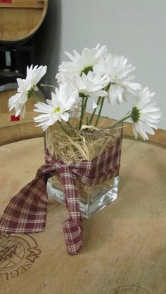 Western theme centerpieces...change the ribbon so that it's not western and it'd be better
