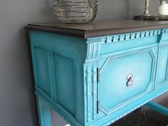 Multi layered turquoise on this stout little buffet. Modern Vintage