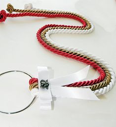 """Marriage Braid Unity Braid, Cord of Three Strands, Rope Braid, Wedding Unity Braid, Unity Cord, Unity Knot, Gods Cords, Marriage Cords,. Many Christian couples have heard about the '3 cord strand' symbolizing God, the man and the wife. This is a COOL idea to do rather than the unity candle! :) Cord of Three Strands - Includes: 3 LARGE (3/8"""" thick) Rayon cords (approx:1 Yard each in length) in three brilliant colors Red, Snow White and Gold, attached to an Embellished ring with a Silver…"""