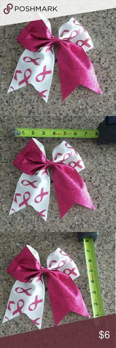 Breast cancer awareness bow New. Attached to black hairbow.   1 bow for $6. 2 bows for $10. 3 bows for $15.  Free mystery solid bow for every 3 bows purchased! No exclusions.  Ask for discount and I will make a listing for you!  These prices are firm. Accessories Hair Accessories