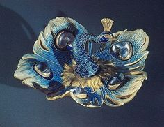 Lalique - 1897-98 Peacock Brooch: chased gold, translucent enamel on gold, moonstones. H. 1 x W. 2-1/4 in