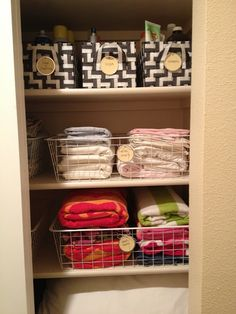 morganize with me: Organized Linen Closet. I love the wire baskets for holding sheets and beach towels.