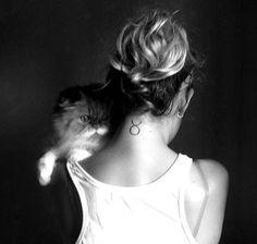 19 Taurus Sign tattoo on back neck
