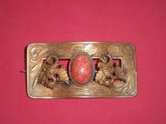 1900s Repousse Coral Glass Cabochon Sash Pin by pasttimejewelry, $80.00  Follow past time jewelry shop by Joe's Gems on Facebook