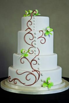 wedding cake with flowers down one side wedding cakes on green ribbon wedding cakes 26880