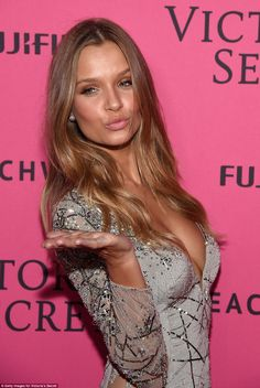 Sealed with a kiss: ModelJosephine Skriver dazzled in a silver sequin embellished dress in grey