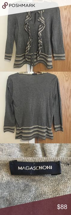 💫Magaschoni cashmere cardigan Magaschoni cashmere gray and white buttoned cardigan with ruffles and cinched waist with tie. No longer have the wash instructions tag or size tag attached but it's a women's small. Great condition. magaschoni Sweaters Cardigans