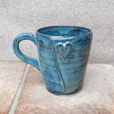 Hand thrown stoneware pottery mug .....with a heart shaped button