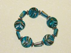 BEADED STRETCH BRACELET-HANDCRAFTED-LAMPWORK-SHELL-SILVER-GOLD-BLUE-& FREE GIFT-$11.99-EBAY