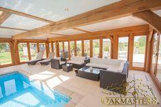 Oak pool house with low profile flat roof - Oakmasters