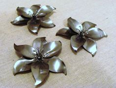 Stamped metal Flowers  poinsettia  set of 3 by TheScrappyMan, $6.00