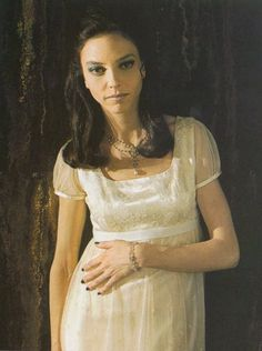 Drusilla wears white Victorian maxi dresses, vintage jewelry, and a black french manicure in season 2 - Buffy the Vampire Slayer