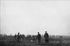 British and German troops meeting in No-Mans's Land during the unofficial truce. (British troops from the Northumberland Hussars, 7th Division, Bridoux-Rouge Banc Sector). Burying those killed in the attack of 18 December (via the Imperial War Museum).